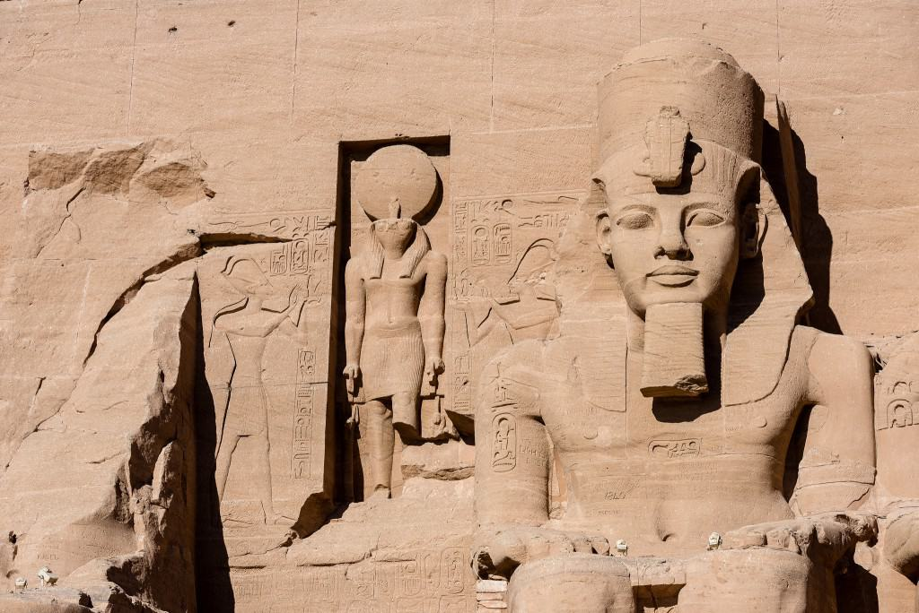 egyptian statues sitting against building