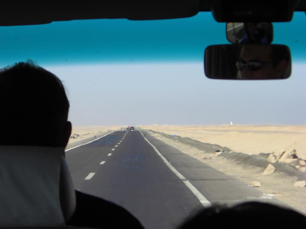 driving on the road through the desert