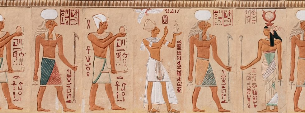 Egyptian figures and hieroglyphics in stone relief