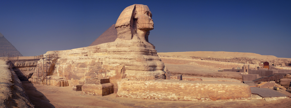 Side View of Great Sphinx of Giza with blue sky
