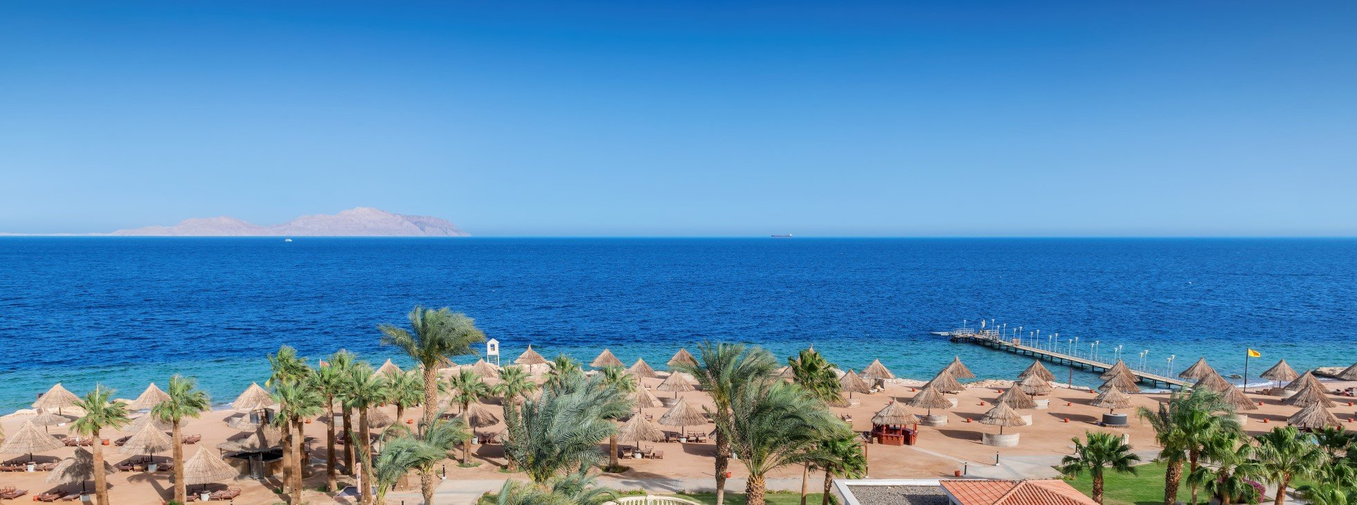 Panoramic view of sunny beach in tropical resort in Red Sea coast in Egypt, Africa
