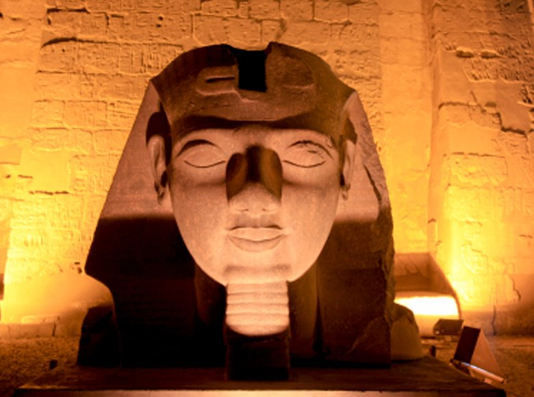 Statue of King Ramses The 2nd Tomb Mask in Luxor Temple night lights