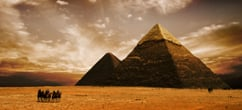 Famous Egyptian Pyramids with Sunset view and camels